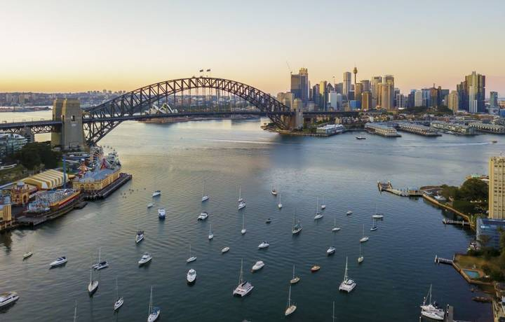 Aerial view of Sydney city skyline during sunrise.