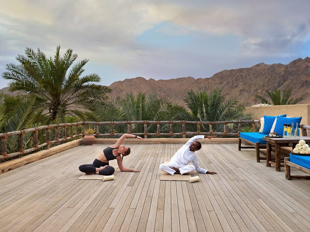Yoga on the pavillion at Zighy Bay