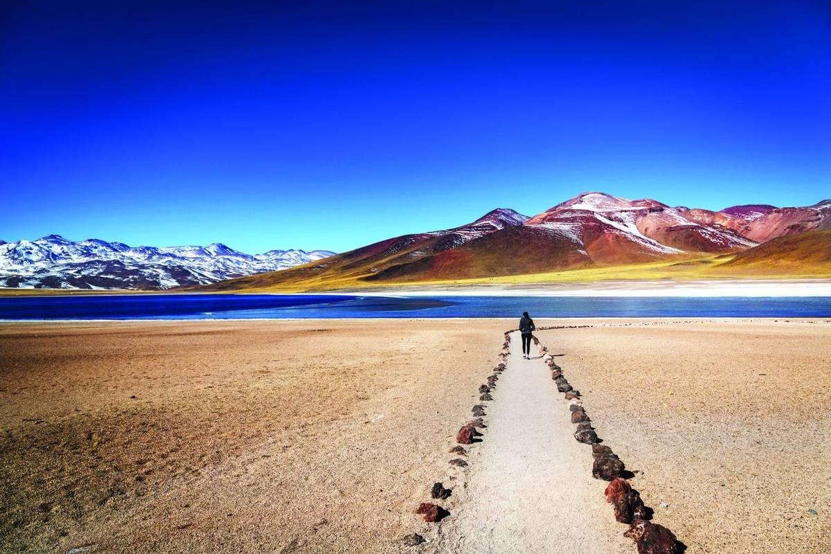 Tourist enjoying the beautiful landscape of Atacama Desert in Chile. Winter time.