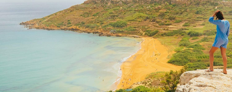 Woman Overlooking Ramla Bay, Gozo