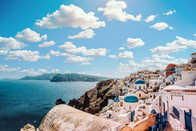 Greece's blue and white hilltop with sea view