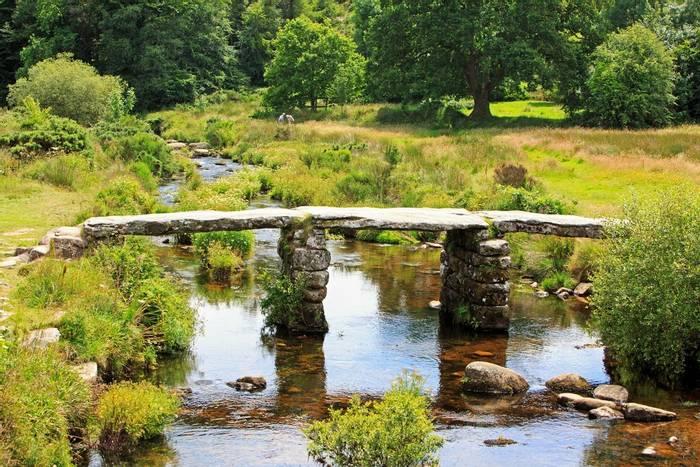 Clapper-bridge-on-the-River-Dart,-Dartmoor-shutterstock_682048015.jpg