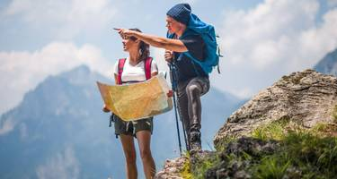 Hikers using map to navigate outdoors