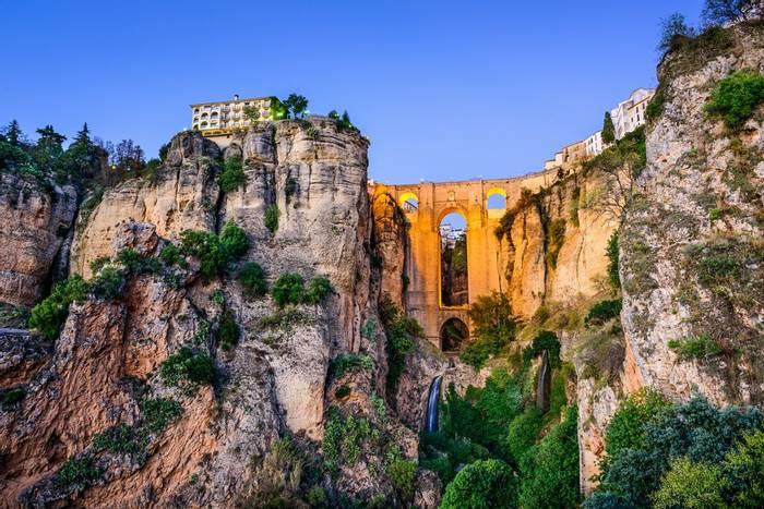 Ronda, Spain at Puente Nuevo Bridge at dusk. shutterstock_246769609.jpg