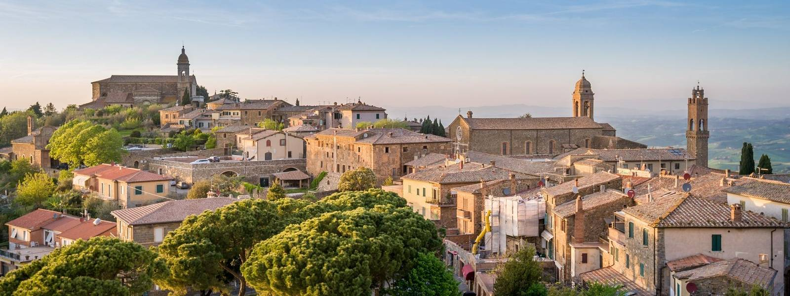 Montalcino old town at the beautiful sunset light. Travel Toscana landscapes, Italy.