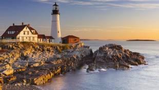 The Portland Head Lighthouse in Maine, USA at sunrise.