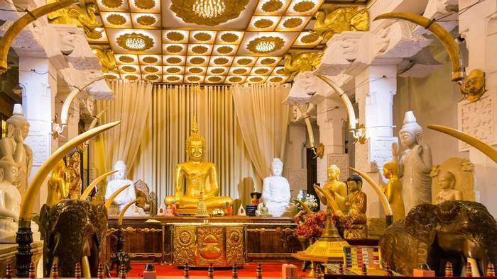 Buddha statue, Temple of the Tooth, Sri Lanka shutterstock_720095884.jpg