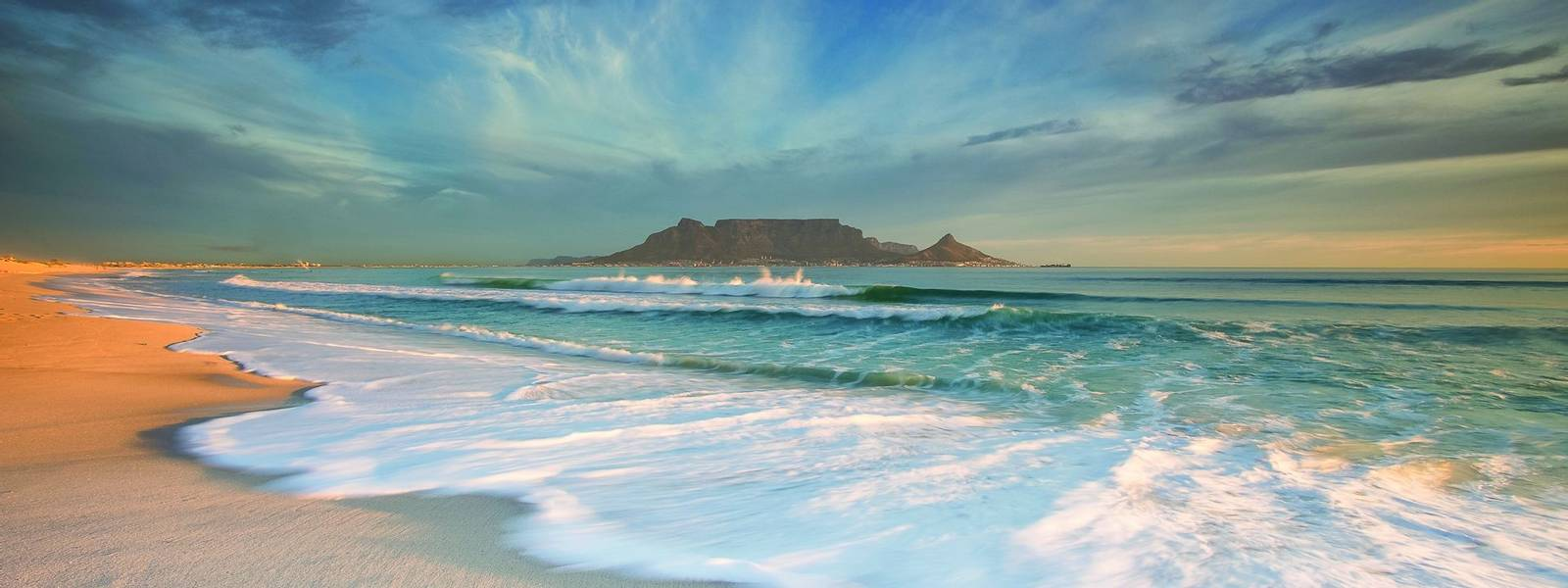 Beautiful wide angle landscape image of Table Mountain in Cape Town South Africa as seen from Blouberg beach