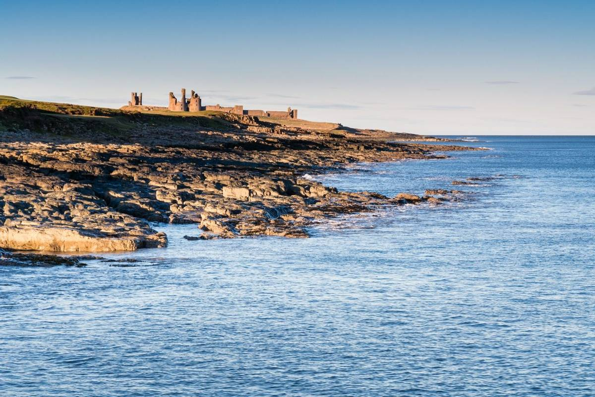 Dunstanburgh Castle from Craster Harbour