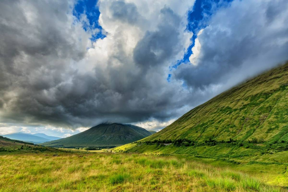 Dramatic Clouds over Beinn Dorain and Beinn Odhar Mountains in Scotland.