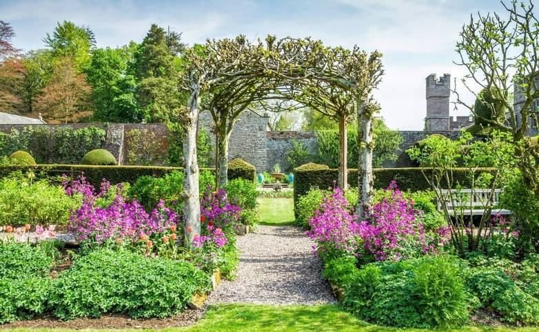 Trellis and flower beds in gardens on grounds of Hutton in the Forest in Cumbria, England.