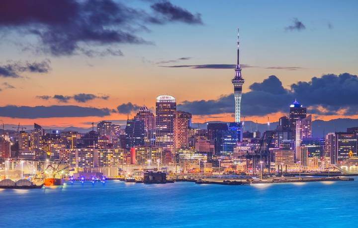 Cityscape image of Auckland skyline, New Zealand during sunset with the Davenport in the foreground.