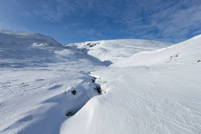 Landscape view of snow-covered mountains, Strathdearn (Findhorn Valley), Highlands, Scotland, February