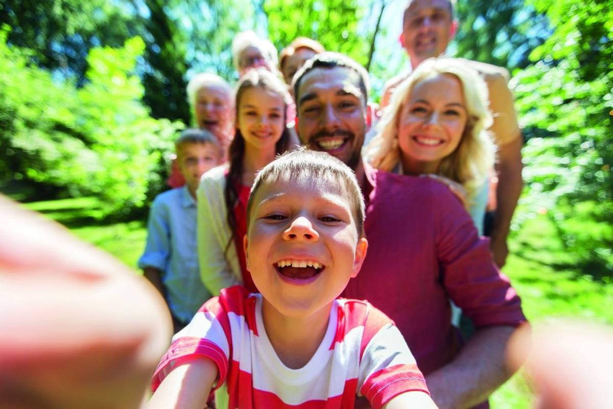 happy family taking selfie in summer garden