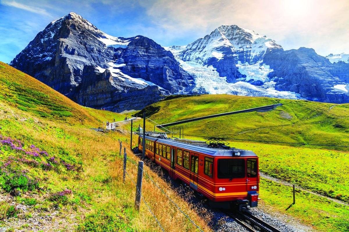 Electric tourist train and Eiger North face,Bernese Oberland,Switzerland