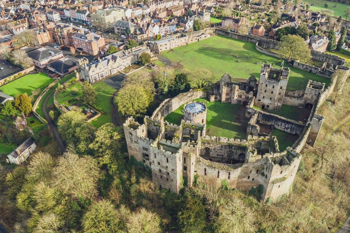 Top down aerial view over ruins of medieval fortification - Ludlow Castle in Shropshire, UK