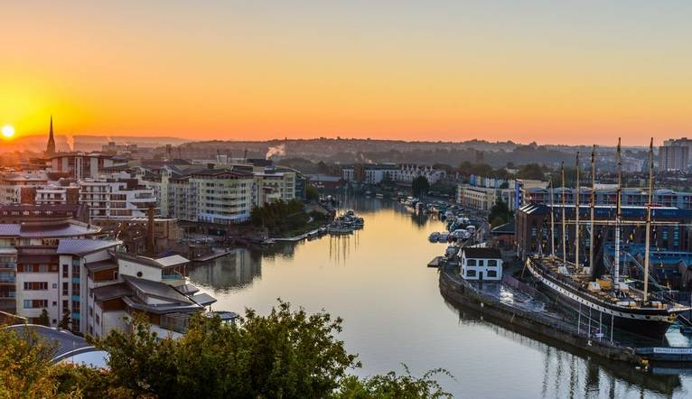 GettyImages-1139690259 High Angle View Of Buildings By River Against Sky During Sunset.jpg