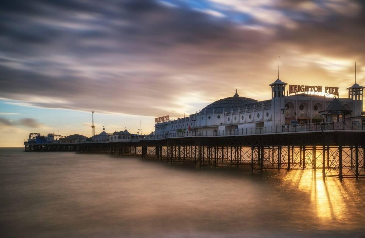 Long exposure Winter sunset over Brighton Victorian pier.