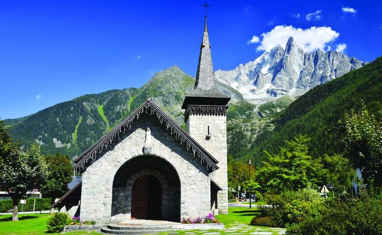 Les Praz de Chamonix and Aiguille Dru mountain