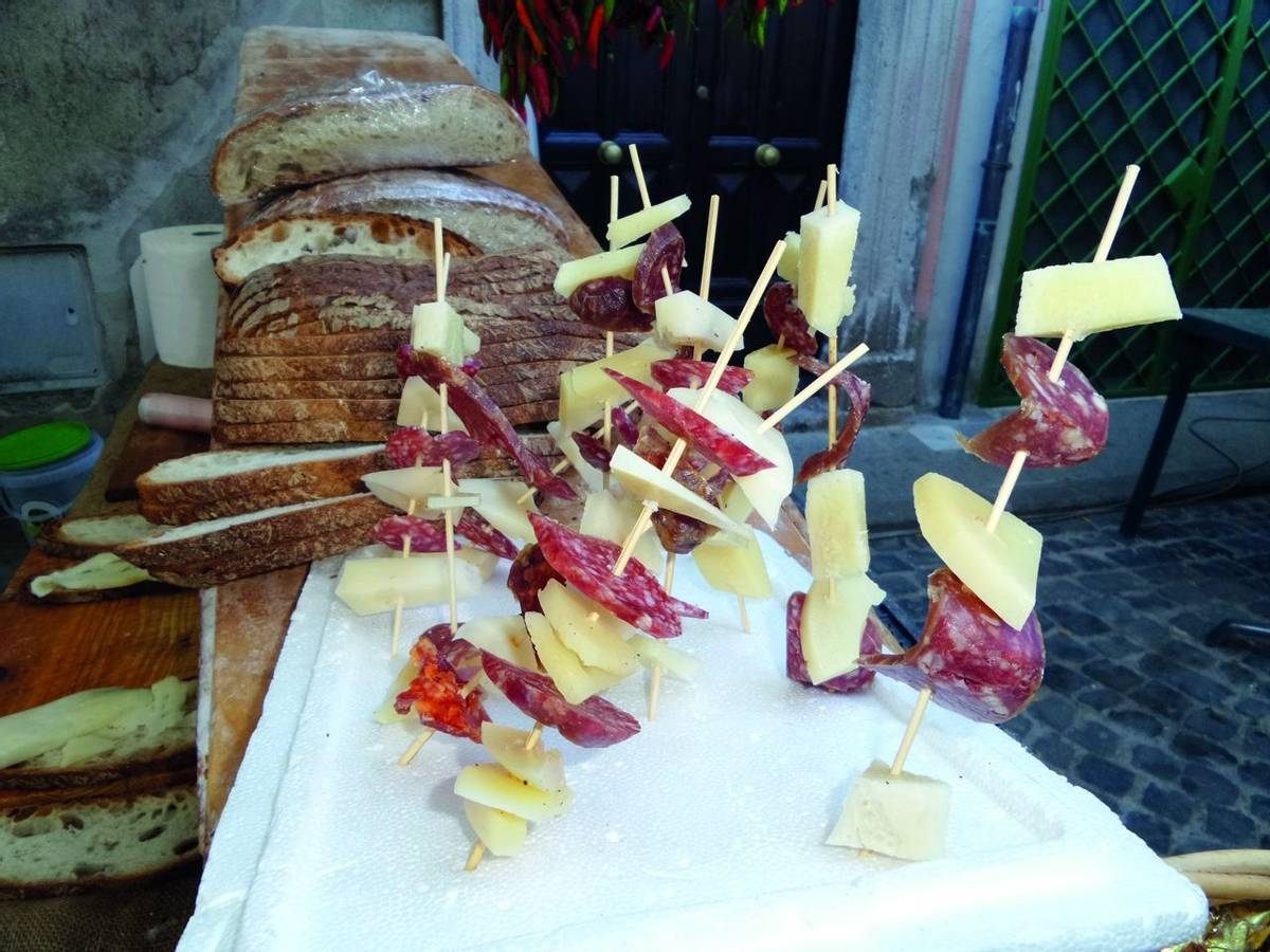 Skewers with cheese, salami and Altamura bread typical from Puglia, Italy.