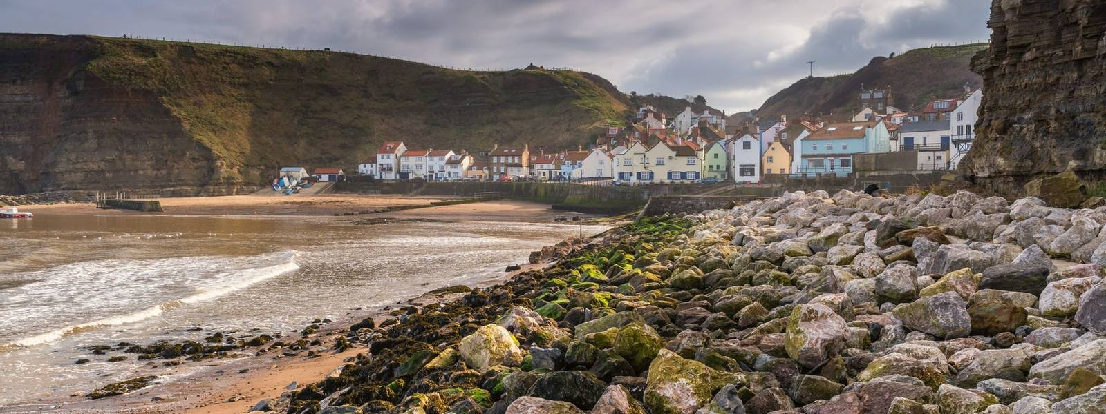 Staithes is a pretty seaside village and fishing port on the North Yorkshire coastline, and is today an attractive tourist d…