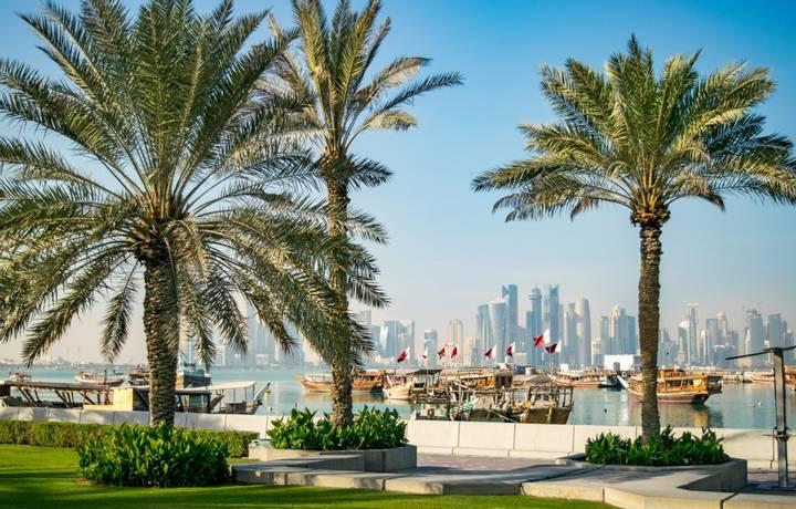 Wide Shot of Corniche, Doha Harbor, and Skyline of Doha's Financial District (West Bay) - Doha, Qatar