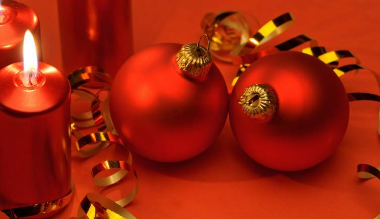 Christmas candles and red spheres. A celebratory composition