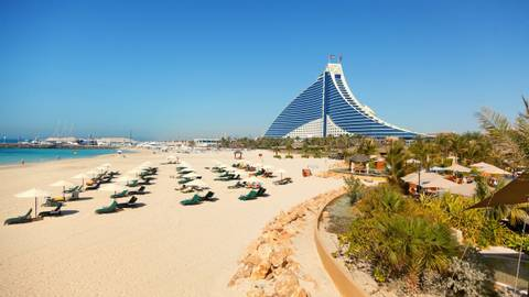 Dubai, United Arab Emirates - March 23, 2011 : Jumeirah Beach hotel with the pure white sand beach and crystal clear water i…