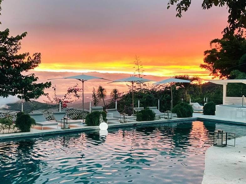 the-retreat-costa-rica-main-pool-4-sunset.jpg