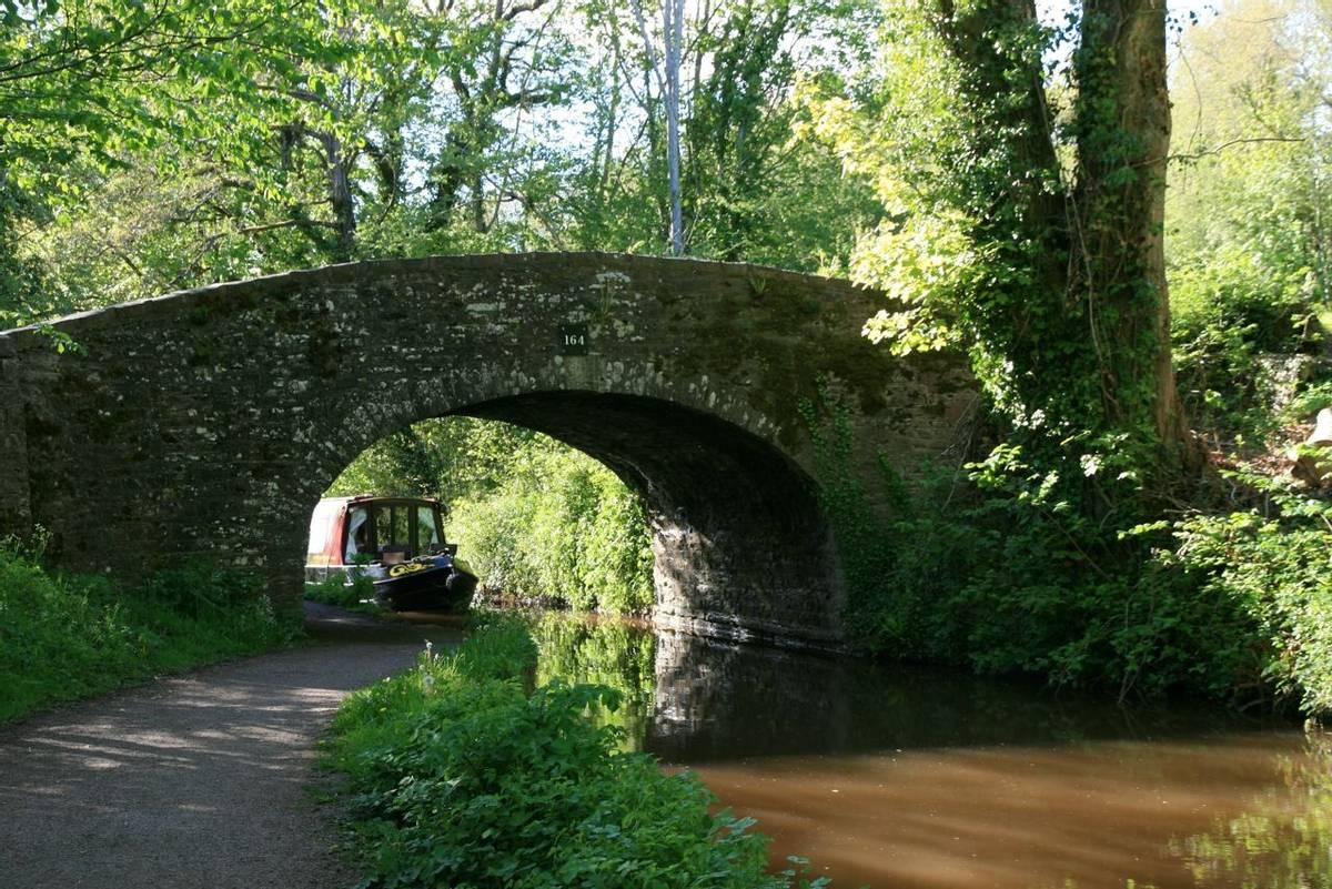 Narrowboat coming through bridge on Brecon Canal.JPG