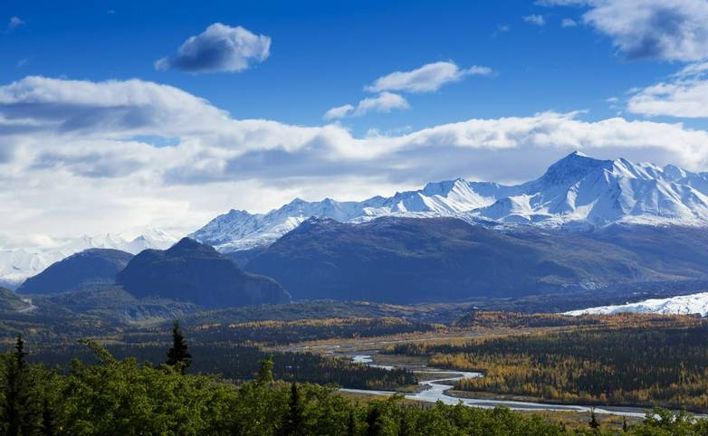 Majestic Chugach Mountain Range and graceful bends of the Matanuska River as seen from Glenn Highway in Alaska.