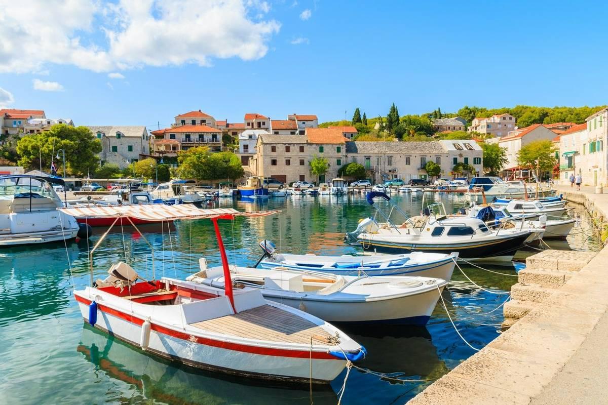 Colorful typical fishing boats anchoring in Sumartin port on Brac island, Croatia