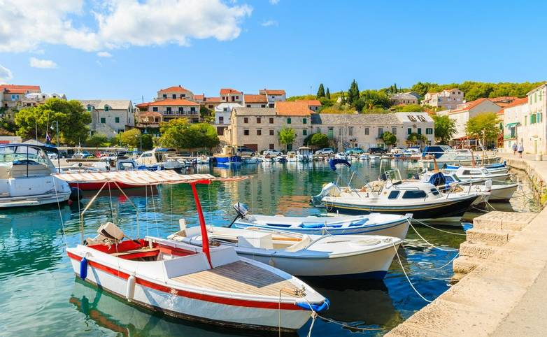 Colorful typical fishing boats anchoring in Sumartin port on Brac island, Croatia