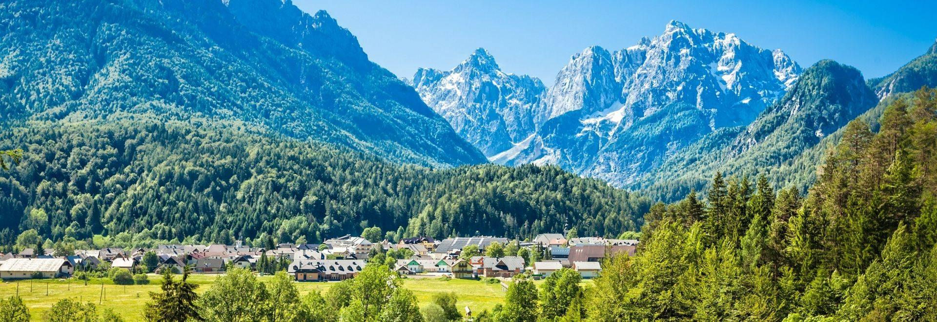 Travel destination Kranjska gora town with Julian alps behind, Slovenia.