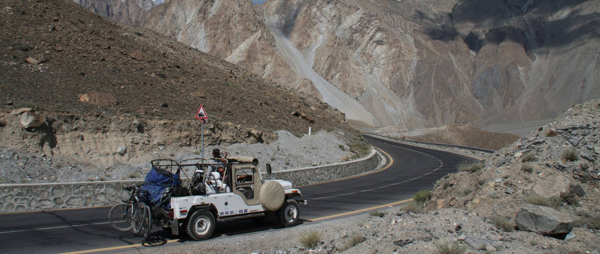 Driving Through Northern Pakistan In An Open Top Jeep