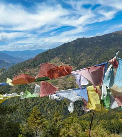 View with prayer flags from the first day of Dagana trek