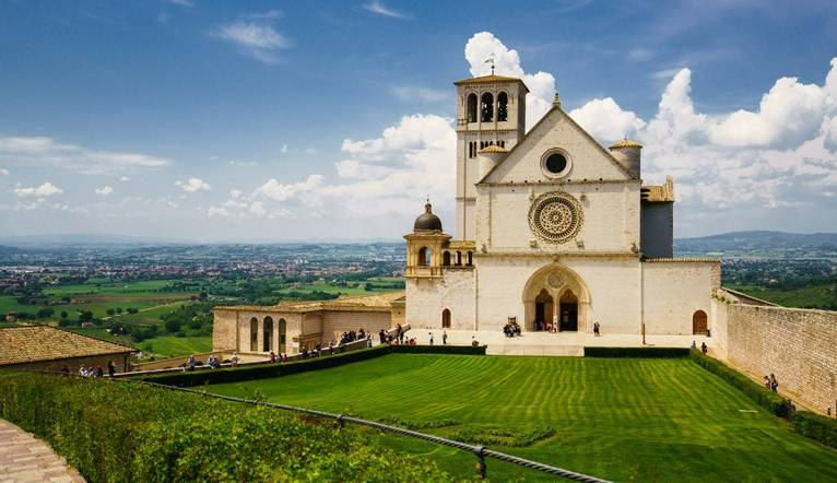 External view of the Church of St Francis of Assisi under rich blue sky and vivid green lawn in foreground. Captured with So…