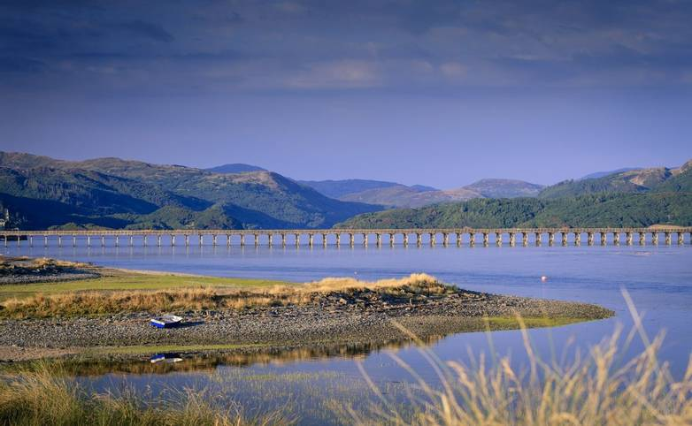 Barmouth Bridge on the Mawddach Estuary Barmouth Gwynedd Wales