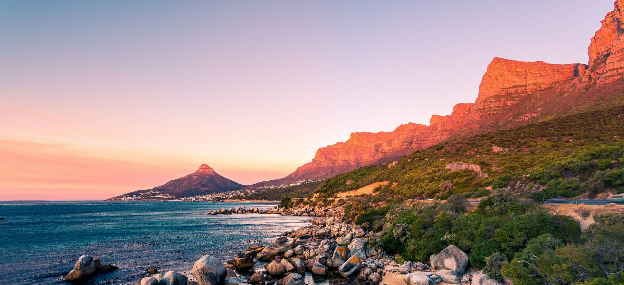 A wide picture of Clifton Beach in Cape Town, South Africa at late afternoon in a beautiful sunset. Colorful and satured tak…