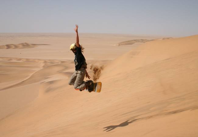 Sand Boarding - Swakopmund, Namibia - Travel Insurance