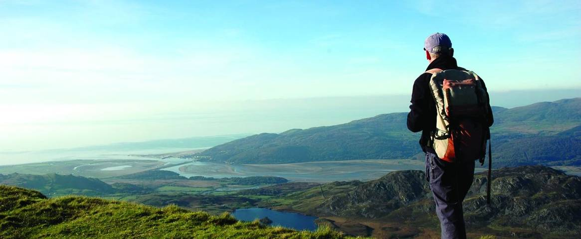 A hiker taking in the view from Cadair Idris in the southern part of the Snowdonia National Park, Wales