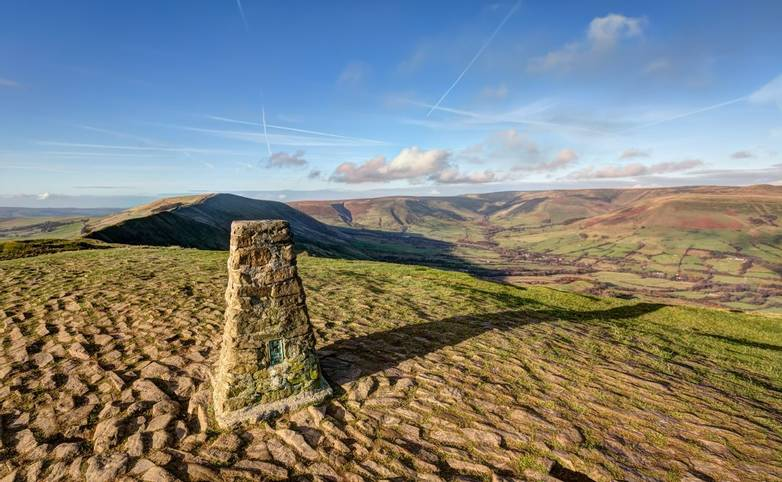 A Triangulation station, or Trig Point at the top of Mam Tor in the Peak District, Derbyshire, UK
