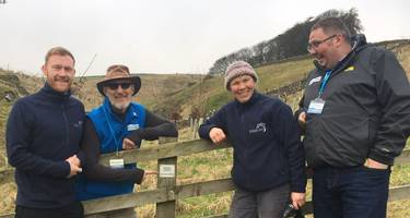 HF Holidays Mark Queen and Mervyn Flecknoe with YDMT's Michael Devlin and Carol Douglas install a plaque to mark HF Holidays' contribution to the Trust's tree planting project