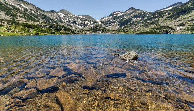 Amazing Panorama of Clear waters of Popovo lake and Demirkapiya pass, Pirin Mountain, Bulgaria