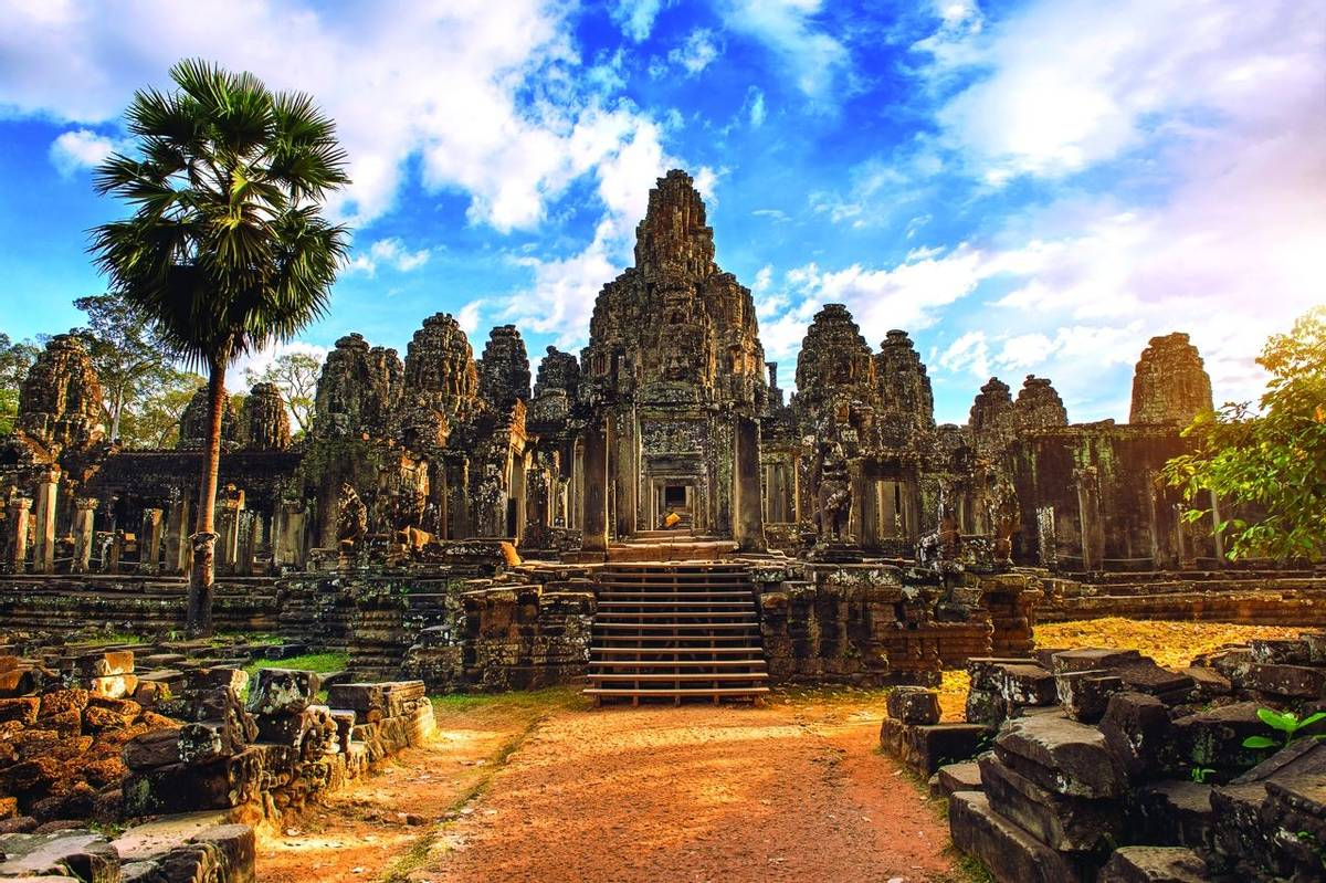 Ancient stone faces at sunset of Bayon temple, Angkor Wat, Siam Reap, Cambodia.