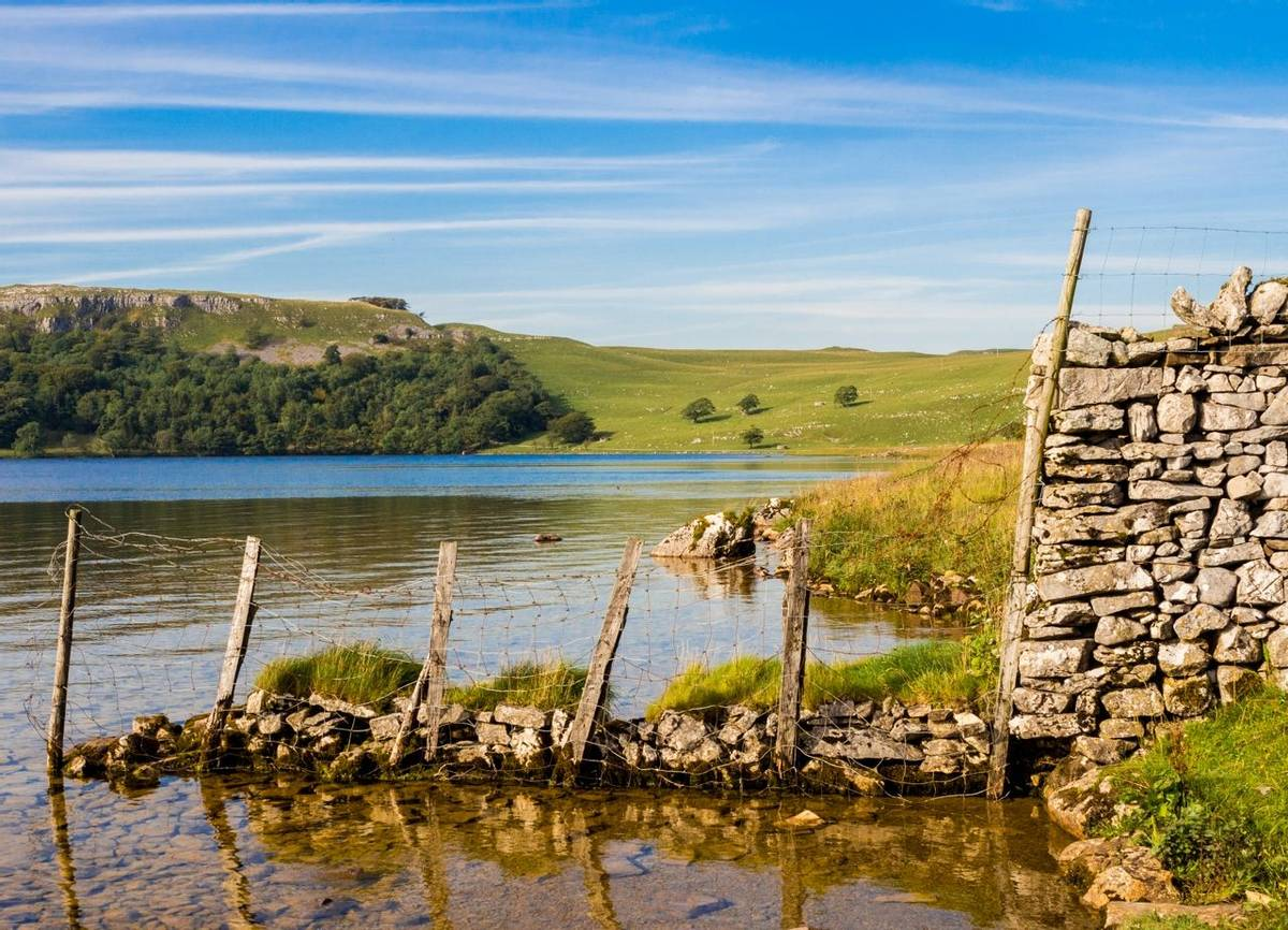 Malham tarn looking beautiuful on a summers evening, Malham, Yorkshire, UK