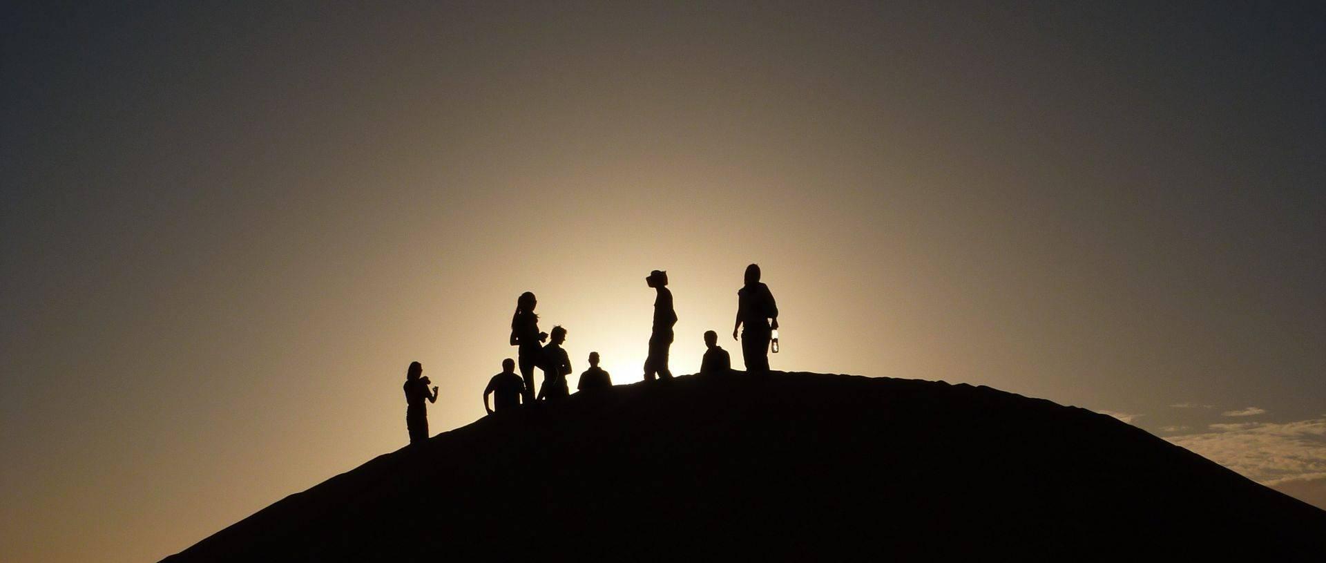 Oasis overlad group enjoying sunset in the desert.JPG