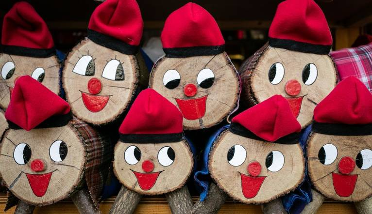 A group of Tiós de Nadal (Christmas Logs) with painted faces and typical Catalan hats for sale in one of the many stands of…