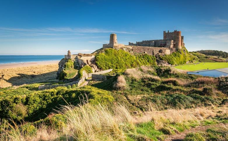 Bamburgh Castle viewed from an elevated hillock, on the Northumberland coastline