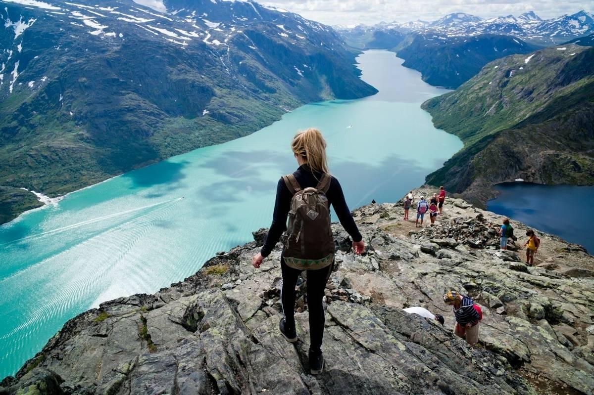 blond woman hiking at Besseggen, Jotunheimen,